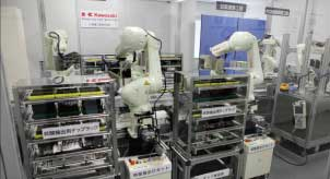 Japan Eyes Use of Robots to Boost COVID-19 Testing | Reuters